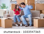 young pair moving in to new... | Shutterstock . vector #1033547365