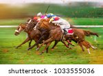 Stock photo race horses with jockeys on the home straight shaving effect 1033555036
