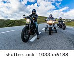 Motorcycle drivers riding in Alpine highway, Nockalmstrasse, Austria, central Europe. - stock photo