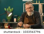 senior jeweler in workshop at... | Shutterstock . vector #1033563796