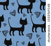 Stock vector seamless pattern of black cats and hearts on a blue background 1033569148