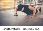 young man pushes the floor.... | Shutterstock . vector #1033569466