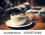 cup of coffee with magazine on... | Shutterstock . vector #1033573285