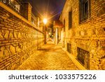 night view to the street in the ... | Shutterstock . vector #1033575226
