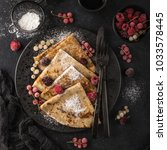crepes with  frozen berries and ... | Shutterstock . vector #1033578445