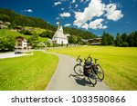 touring bicycles in a village... | Shutterstock . vector #1033580866