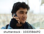 young man making phone call | Shutterstock . vector #1033586692