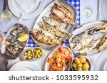 fish feast  sea bass  golden ... | Shutterstock . vector #1033595932