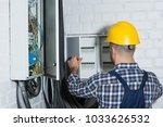 male electrician repairing... | Shutterstock . vector #1033626532