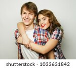 couple in love.young woman and... | Shutterstock . vector #1033631842