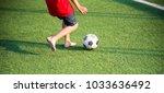 children play football with...   Shutterstock . vector #1033636492