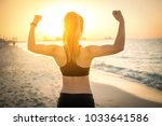 back view of strong sporty girl ... | Shutterstock . vector #1033641586