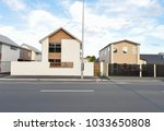 modern townhome side the road... | Shutterstock . vector #1033650808