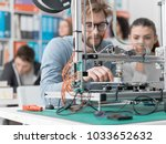 engineering students using a 3d ... | Shutterstock . vector #1033652632