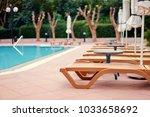 comfort vacation. sunloungers... | Shutterstock . vector #1033658692
