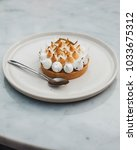 merengue dessert served in cafe | Shutterstock . vector #1033675312