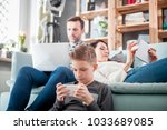 family with laptop  tablet and... | Shutterstock . vector #1033689085