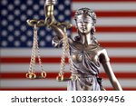 symbol of law and justice with... | Shutterstock . vector #1033699456