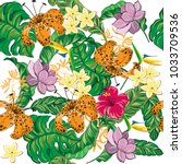 tropical leaves and flowers... | Shutterstock .eps vector #1033709536