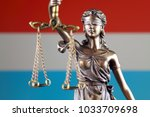 symbol of law and justice with... | Shutterstock . vector #1033709698
