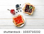delicious toasts with sweet... | Shutterstock . vector #1033710232