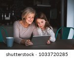 a small girl and grandmother...   Shutterstock . vector #1033720285