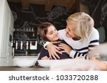 a small girl with grandmother... | Shutterstock . vector #1033720288