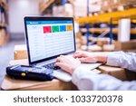 woman warehouse worker or... | Shutterstock . vector #1033720378