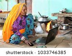 indian rural old lady works on... | Shutterstock . vector #1033746385