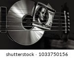 play for money with guitar and... | Shutterstock . vector #1033750156