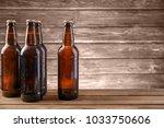 fresh beer in glass bottles on... | Shutterstock . vector #1033750606