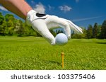 hand placing golf ball on tee... | Shutterstock . vector #103375406
