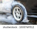 drag racing car burns rubber... | Shutterstock . vector #1033769512