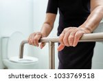 elderly woman holding on... | Shutterstock . vector #1033769518