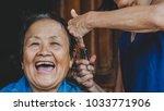 protrait happy old woman... | Shutterstock . vector #1033771906
