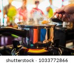 closeup of a pot on gas stove... | Shutterstock . vector #1033772866