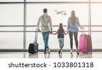 family in airport. attractive... | Shutterstock . vector #1033801318