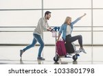 romantic couple in airport.... | Shutterstock . vector #1033801798
