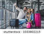 family in airport. attractive... | Shutterstock . vector #1033802215