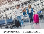 family in airport. attractive... | Shutterstock . vector #1033802218