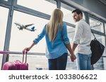 romantic couple in airport.... | Shutterstock . vector #1033806622