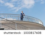 businessman on roof and look... | Shutterstock . vector #1033817608