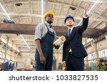 confident inspector in... | Shutterstock . vector #1033827535
