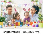 mother  father and daughters... | Shutterstock . vector #1033827796