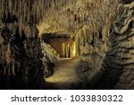 the caves are authentic... | Shutterstock . vector #1033830322