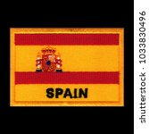 Small photo of Spain flag ensign emblem, embroidery patch on isolated black background with saved clipping path.