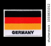 Small photo of Germany flag ensign emblem, embroidery patch on isolated black background with saved clipping path.