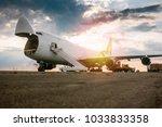 unloading wide body transport... | Shutterstock . vector #1033833358