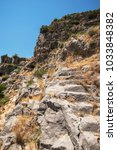 Small photo of Ancient lycian Myra rock tomb ruins at Turkey Demre