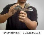 investments in thai baht   Shutterstock . vector #1033850116